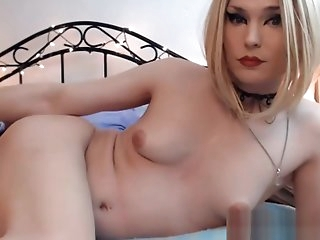 Pretty Blonde Tranny Takes in a Hard Cock